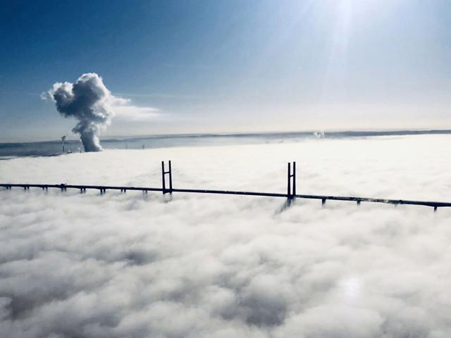 UK bridge looks ethereal shrouded in fog in stunning aerial pics
