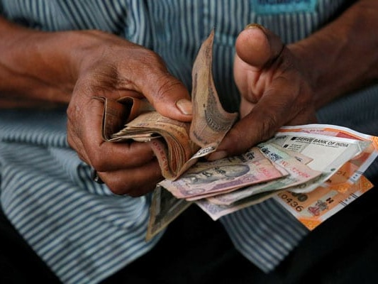 Rupee Declines By 16 Paise To Settle At 72.01 Against Dollar