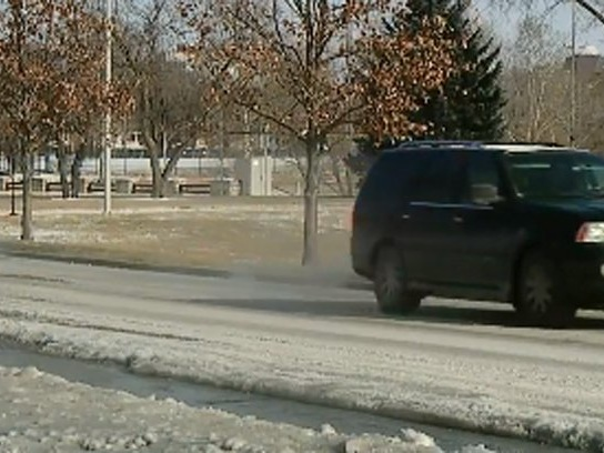 Water bubbling up on Ward Parkway creates dangerous icy road conditions