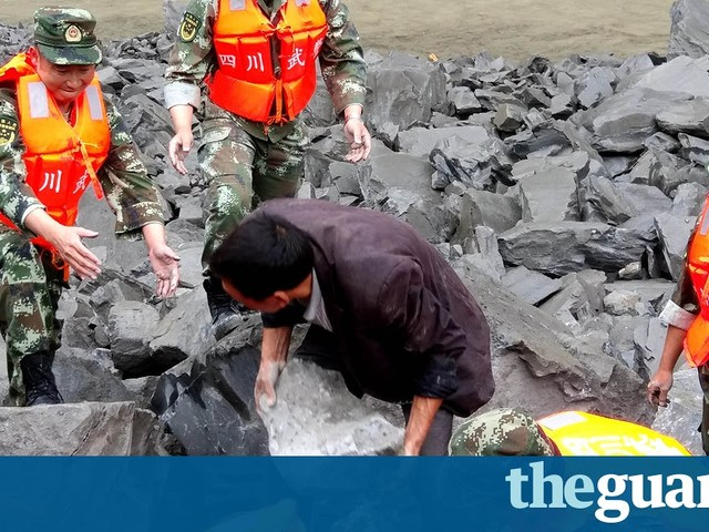 China landslide: more than 140 people feared buried