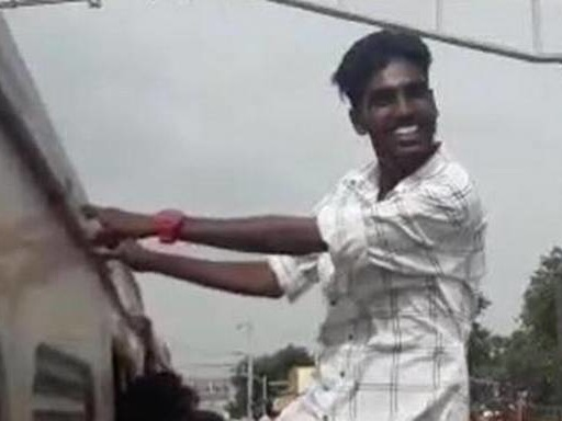 What safety? Students seen hanging from window of train