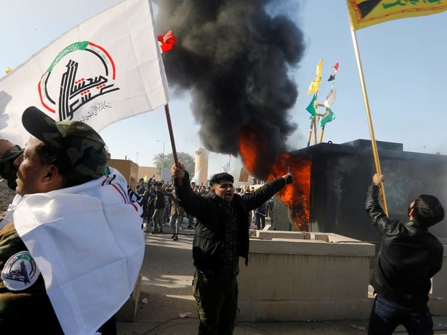 The US is sending roughly 100 more Marines to defend the embassy in Baghdad after violent protesters stormed the gate