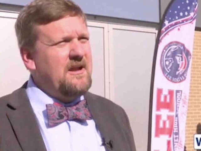 HS principal allegedly says football players should stand for national anthem or quit team. Now he's on leave.