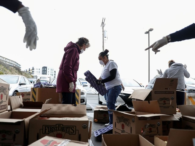 Food banks sought relaxed federal rules to minimize contact. The USDA has stalled those requests, officials say.
