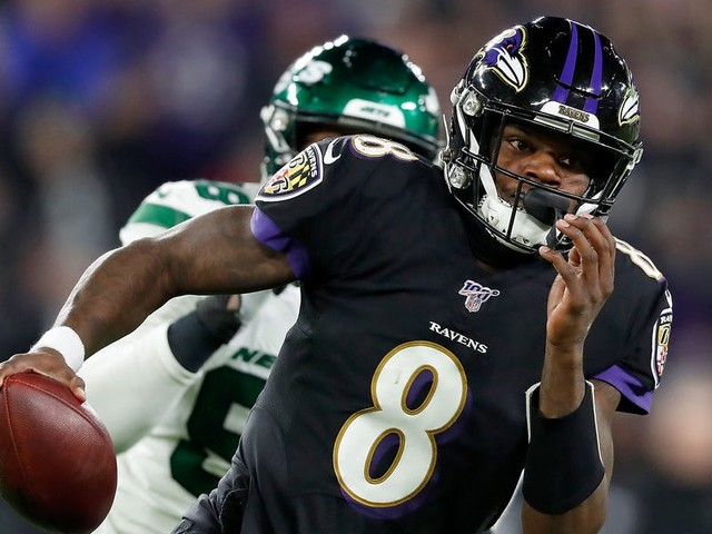 Lamar Jackson didn't realize he had broken Michael Vick's rushing record until running back/hype man Mark Ingram told him