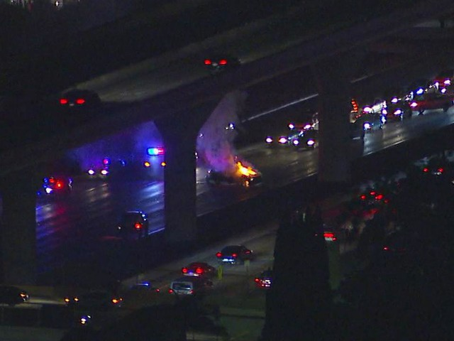 Police chase ends in car crash, fire on NB 110 Fwy in downtown Los Angeles