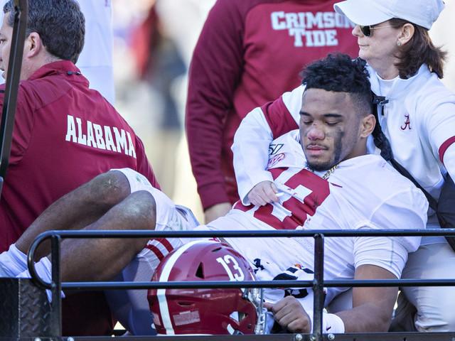 Alabama QB Tua Tagovailoa taken off after right hip injury