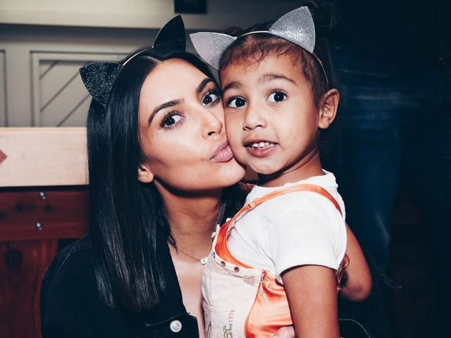 Fans are saying Kim Kardashian West looks just like North in a throwback photo she shared of her with Khloe and Kourtney as kids