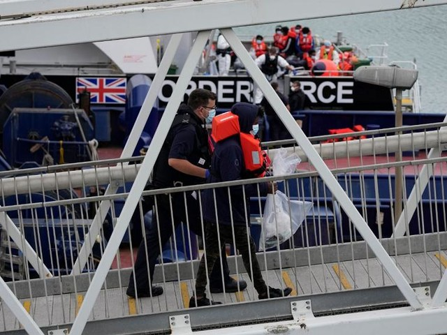 Record number of migrants cross Channel in a single day, says UK Home Office