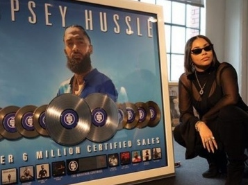 HUSTLE & MOTIVATE: Lauren London Poses With Nipsey Hussle's Platinum Plaques At Pre-Grammy Event After Starring In PUMA x TMC Collection Campaign