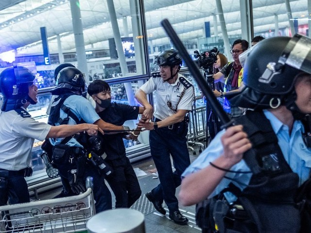 Chaos Grips Hong Kong's Airport as Police Clash with Protesters
