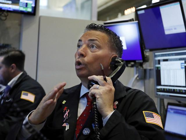 Stocks slide as rate cuts stoke fear of an economic slowdown