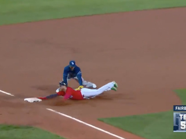 A Red Sox runner was controversially called out at third after an amazing throw by the Rays