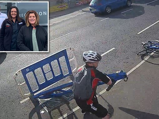Hilarious moment an enraged cyclist launches safety barriers in to the path of amused pedestrians