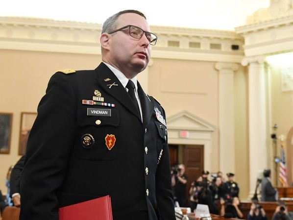 Impeachment witness Lt. Col. Alexander Vindman escorted from the White House