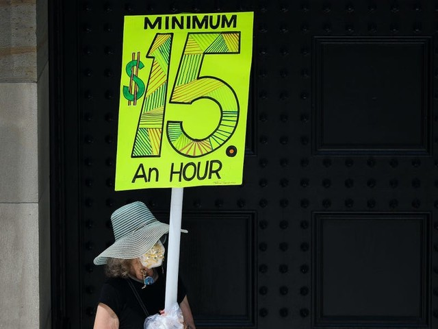 A $15 federal minimum wage could be on the horizon but economists are mixed on how it may pass and its impact