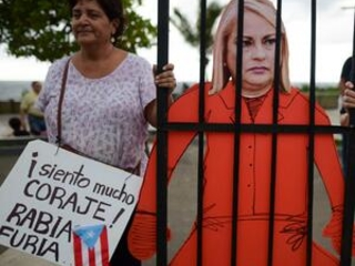 Puerto Ricans protest in anger over unused emergency aid