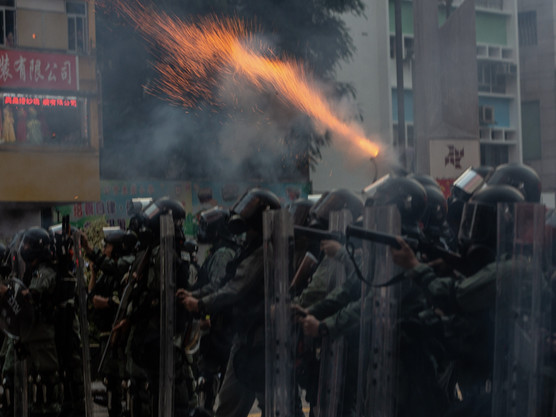"""Hong Kong Officer Faces Death Threats After Firing Live Round, Says He """"Doesn't Regret"""" It"""