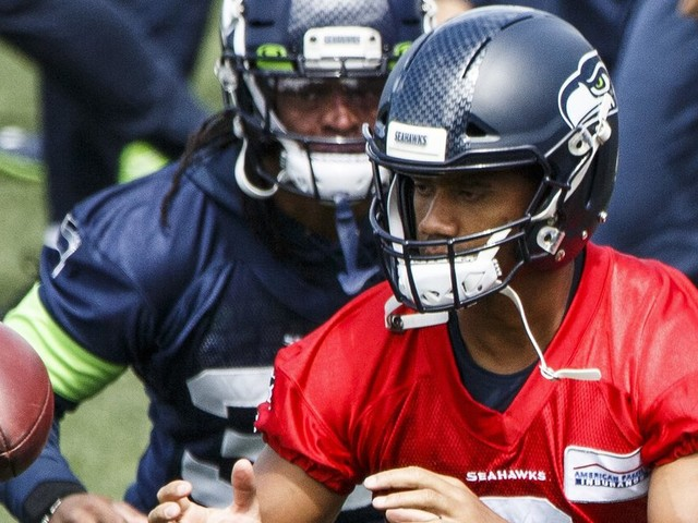 Russell Wilson is back working with the Seahawks, but some questions still must be answered