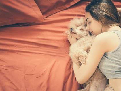 Women may sleep better next to dogs than people