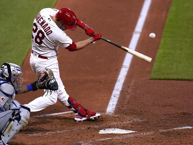 Wainwright, Cards win 5th in row; Mets fire hitting coaches