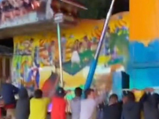 Terrifying video shows tragedy narrowly avoided when carnival ride spins out of control; festival-goers save the day