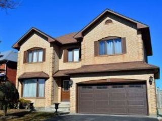 How a Garage Door Installation Can Increase Your Home's Value