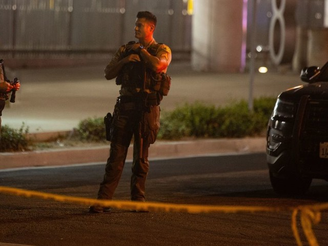 Graphic photo taken in moment following shooting of 2 LA officers shows deputy shot through the jaw saving fellow cop with tourniquet and radioing for help