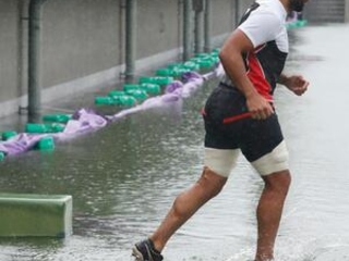 As Japan braces for typhoon, rugby squad trains in the rain