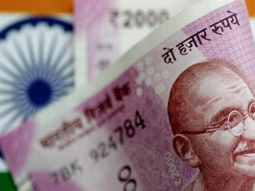 Rupee slips 14 paise to 71.11 against USD in early trade