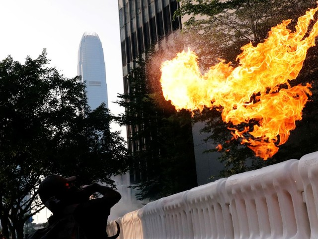 Hong Kong protesters hurl petrol bombs in latest wave of unrest