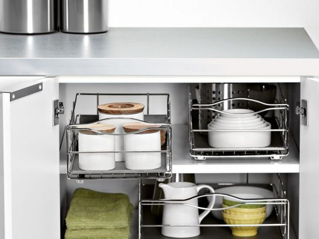 I hacked my disorganized kitchen pantry using these DIY pull-out cabinet drawers, and they eliminated so much clutter