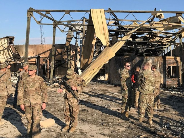 Rockets hit Iraqi base with US troops less than a week after Biden officials said Syria strikes would 'de-escalate' tensions in the region