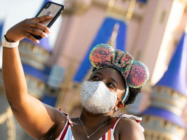 Disney World may soon allow vaccinated people to take off their masks following new CDC guidance, its CEO said