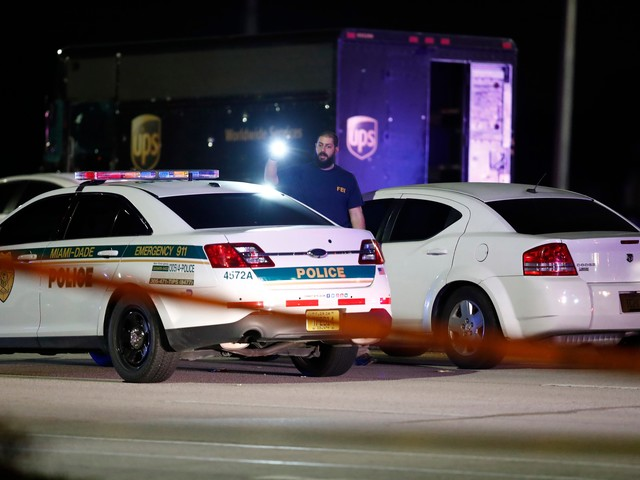 A Florida man 'sitting in his car' was killed in UPS hijacking shootout. His family is calling for an investigation