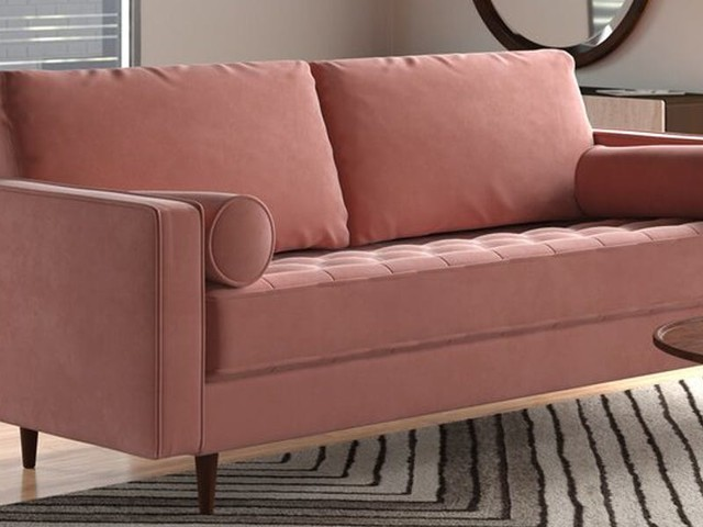 This velvet AllModern couch looks more expensive than it really is — I'm impressed by the quality and durability
