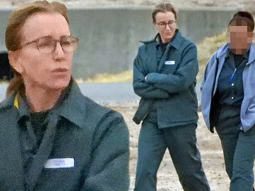 Felicity Huffman chats with fellow inmate as she strolls around prison