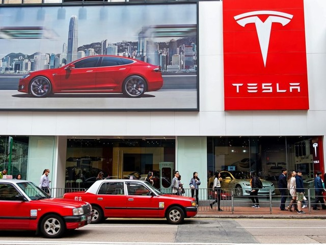 Car fires in China spur investigations by Tesla and its rival NIO