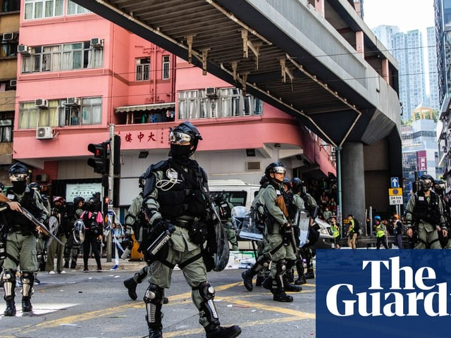 Hong Kong: protesters converge on financial centre after day of unprecedented violence