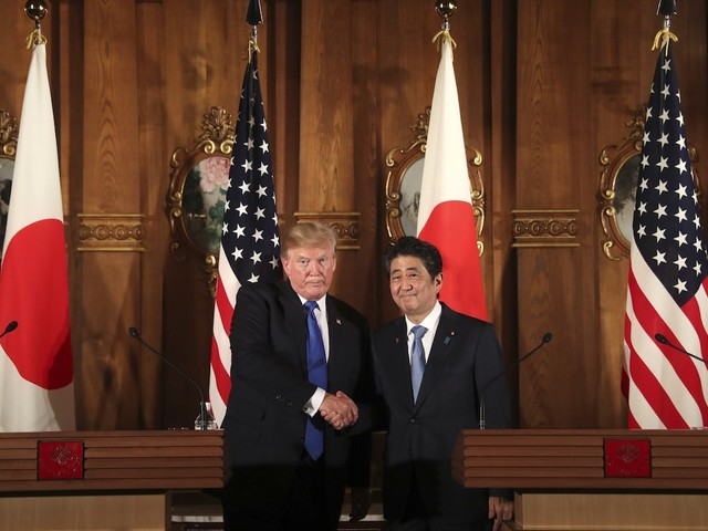 Trump signs trade deal with Japan as tensions escalate with China and the EU