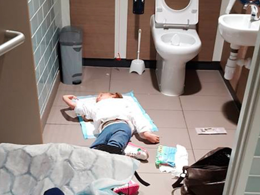 Why Everyone Needs to See This Photo of a Girl With Disabilities on the Bathroom Floor