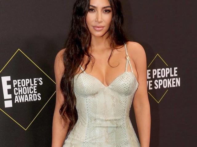 Kim Kardashian Wins Flashback Friday With Iconic Old Fitting Photos