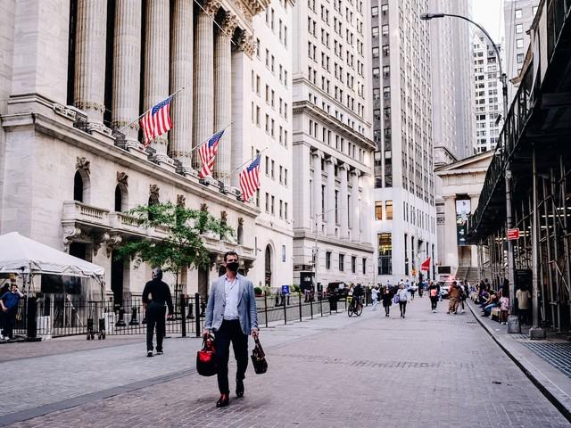 Stocks slide as Dow barrels toward worst week since last year