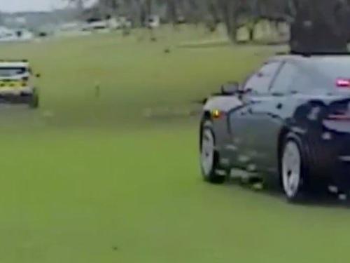 Dash cam video shows a bumpy police chase through a golf course in Florida
