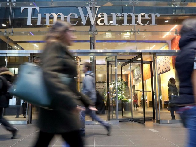 AT&T CEO Randall Stephenson says he is prepared to litigate Time Warner deal