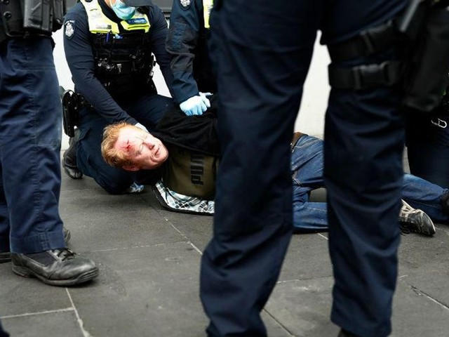 Disturbing videos from Australia show police engaging in brutal violence, going door-to-door asking residents about participating in protests