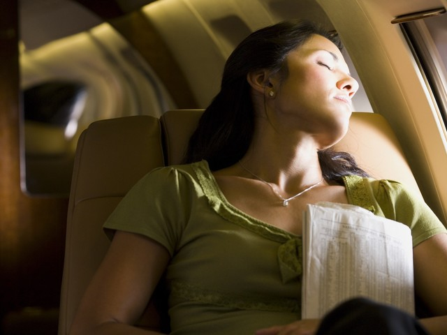 Sleeping on a Plane? Here's How to Make Sure No One Steals Your Stuff