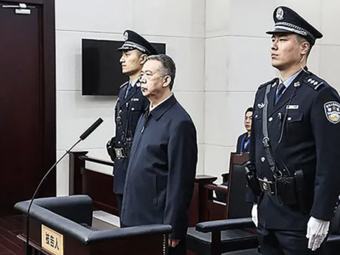 Former Interpol Chief Sentenced To 13.5 Years In A Chinese Prison