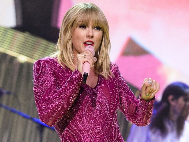 Taylor Swift Wildly Whips Her Hair While Rocking Out to Her Own Song at the Club