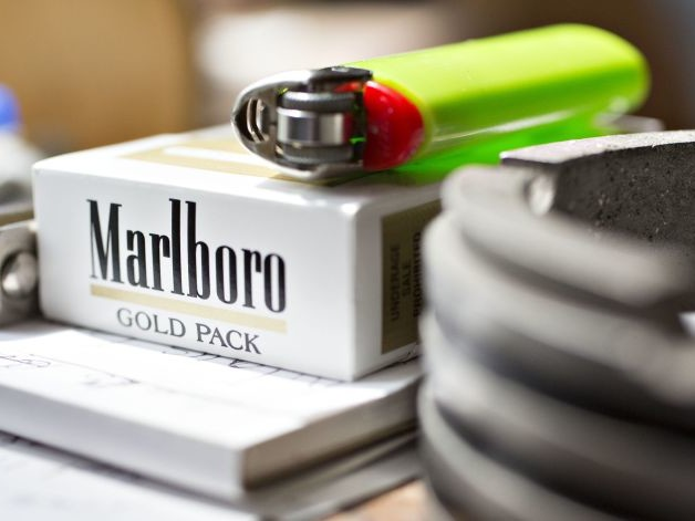 Philip Morris Cuts Profit Forecast After Canada Court Ruling